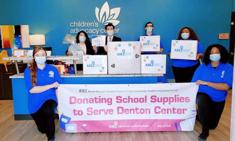UNT  student pose with comfort kits they donated to the Children's Advocacy Center for Denton County