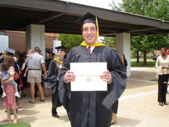Man Smiling With Graduation Diploma