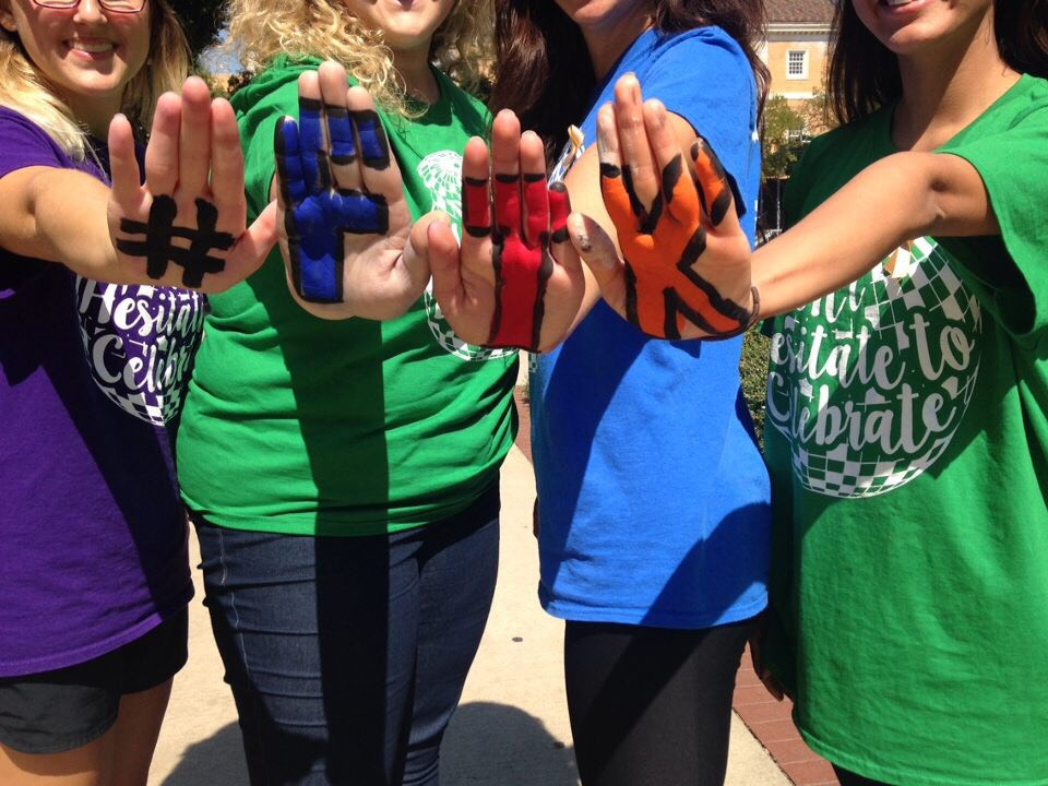Hands displaying #FTK