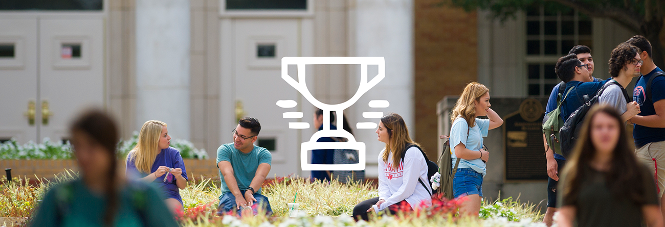 Students walking on campus with trophy icon over the photo