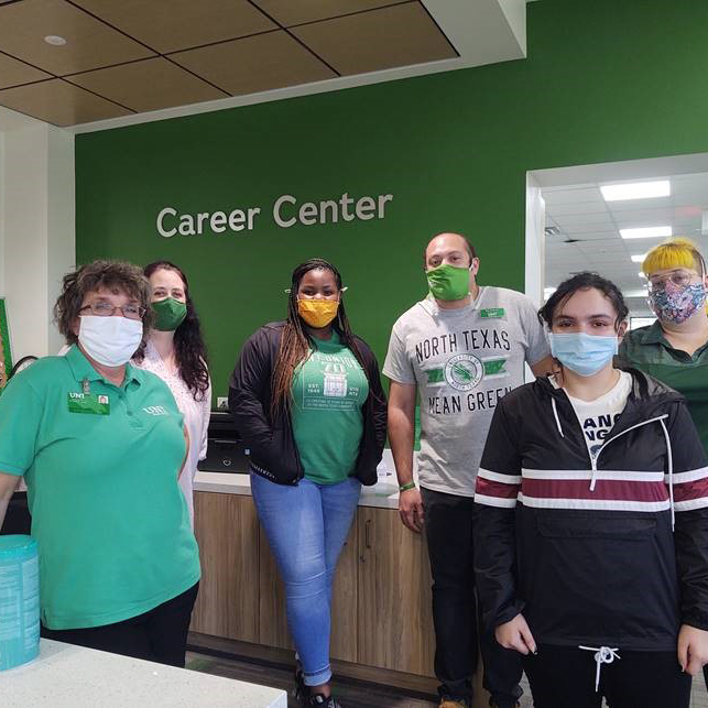 Patricia with employees at career center
