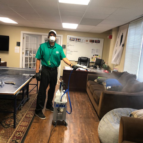Peter in residence hall cleaning with mask