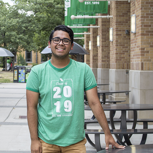 Oscar Celis in front of UNT union