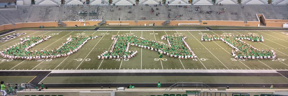 Students making the letters UNT on football field