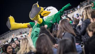 Scrappy Crowd Surf at Apogee during evening football game.