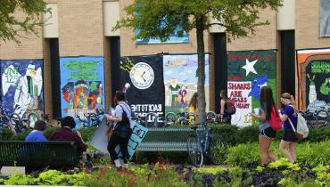 students in library mall with painted homecoming signs