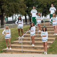 North TexasCOED group posed in front of stairs in white uniform
