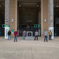 """North Texas Guys in flannels in front of """"Mean"""" Joe Greene statue in Apogee stadium"""