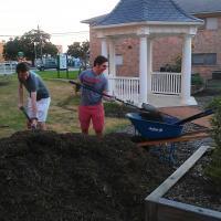 Gardners shoveling