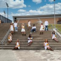 North Texas COED dressed in white on the stairs