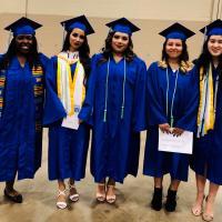Students Smiling at Graduation