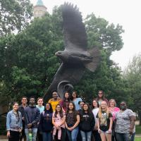 Students Smiling With Eagle Statue