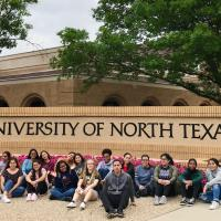 Students Smiling With University Of North Texas Sign