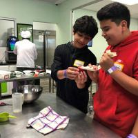 Students at Gainesville Junior High, Leo & Leo, prepare dessert at Young Chef Academy