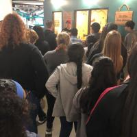 Students receive a tour and speak about the history of the National Video Game museum.
