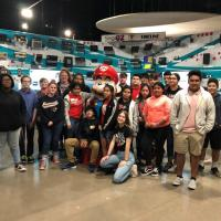 Students pose with Mario after visiting the National Video Game museum.