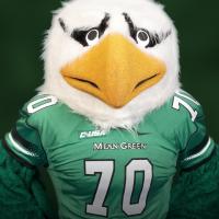 Headshot of Scrappy in Green Football Jersey