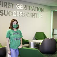 UNT student assistant Tiffany Nguyen in the new First Generation Student Success Center Suite with mean green shirt and mask