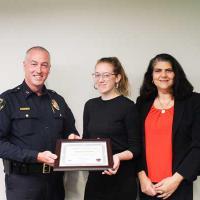 Meagan Leftwich receiving award