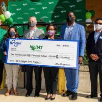 Kroger and UNT administrators with Kroger check