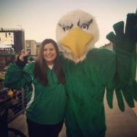 Woman Smiling With UNT Eagle Mascot