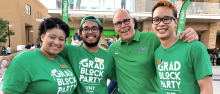 Graduating students with UNT president