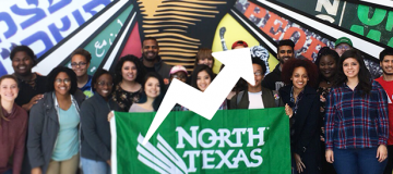 Students in front of brightly colored wall holding UNT flag