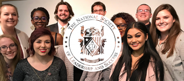Students with National society of ledarship and success logo over the photo