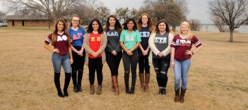 Sorority women wearing tee shirts with Greek letters