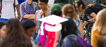 Students walking on campus with grad cap logo on top of photo