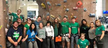 Transfer Ambassadors in front of rock climbing wall