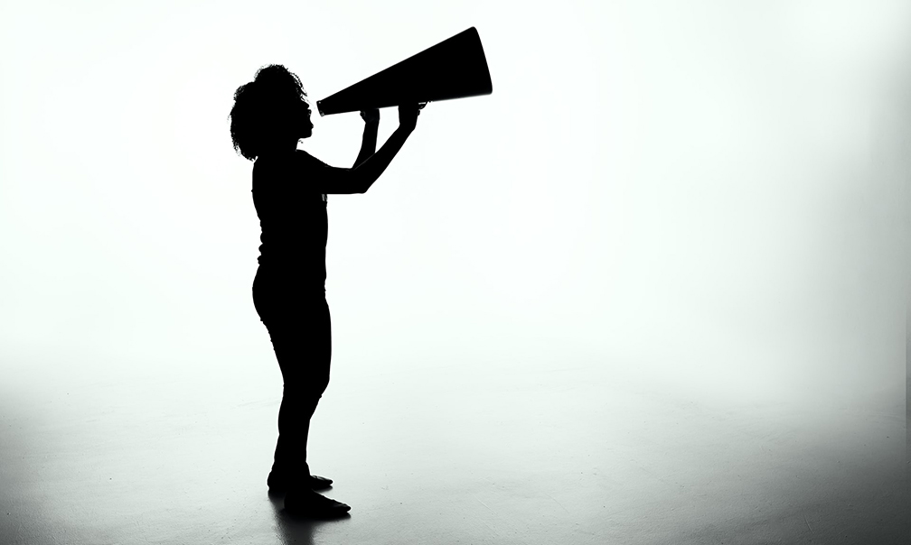 image of silhouette of person with bullhorn