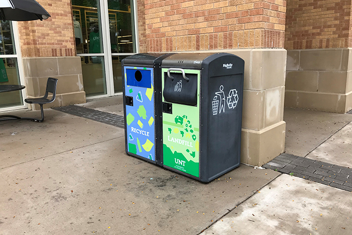 trash can that has recycling and trash options